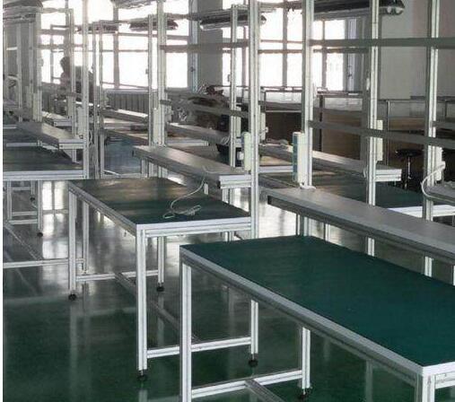 防静电工作台主体框架一般采用铝型材,台面则采用防静电防火板或防静电台垫